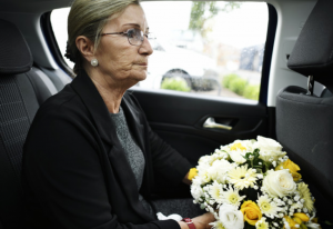 Widow sitting in condolence car